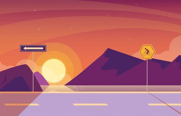 Natureza da paisagem do nascer do sol com sinalização para ciclista