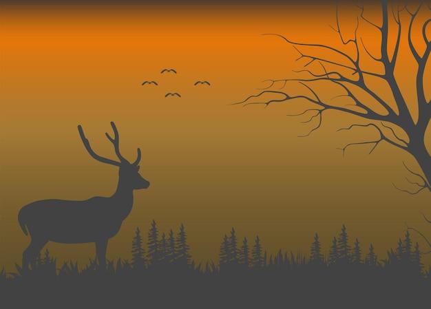 Natureza selvagem quando escurece e um cervo parado nos arbustos