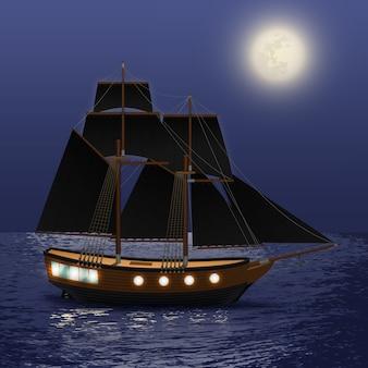 Navio vintage com velas negras no fundo do mar à noite