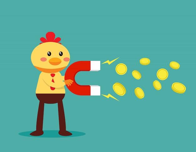 Negócios de frango segurando o ímã e atrair dinheiro