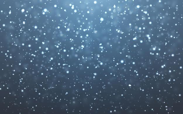 Neve de natal. flocos de neve caindo em fundo escuro. queda de neve.