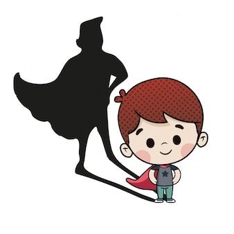Niño valiente con sombra de superhéroe