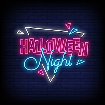 Noite de halloween com sinais de néon estilo texto