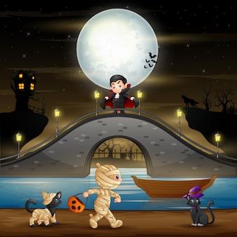 Noite de halloween com vampiro, múmia e gatos