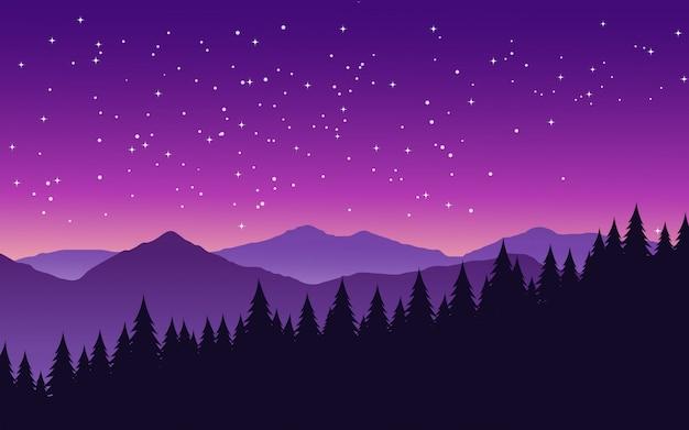 Noite estrelada maravilhosa sobre pinhal com montanha