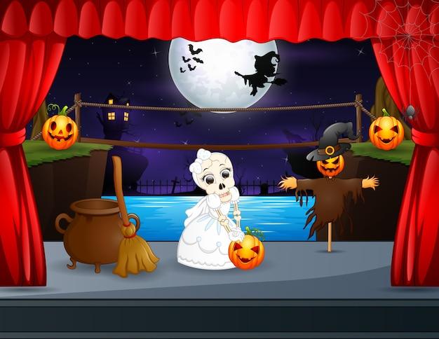 Noiva com caveira de ilustração e espantalho no palco