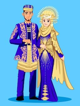 Noivas minangkabau em roupas tradicionais de azul e ouro.