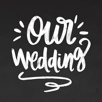 Nossas letras de casamento no quadro-negro