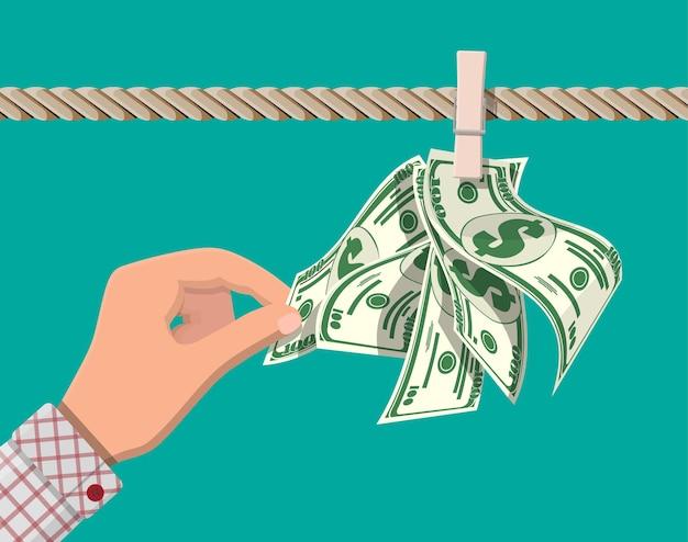 Notas de dólar molhadas penduradas na corda presa com alfinetes de roupa. conceito de lavagem de dinheiro. dinheiro sujo. Vetor Premium
