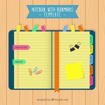Notebook com marcadores coloridos