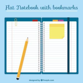 Notebook com marcadores no design plano