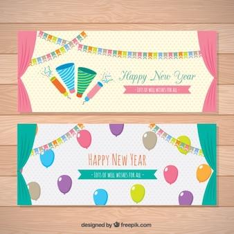 Novas bandeiras coloridas ano com balões e grinaldas