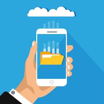 Nuble-se o conceito de armazenamento isolado no fundo azul. mão segura o telefone com o upload de arquivos para a nuvem. processo de download