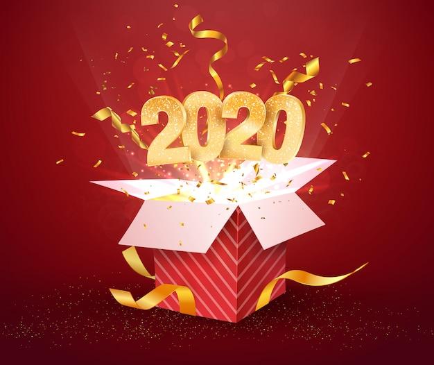 Número 2020 e caixa de presente vermelha aberta com confetes de explosões isolado