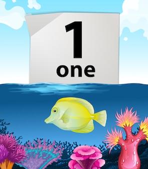 Número um e um peixe a nadar debaixo de água