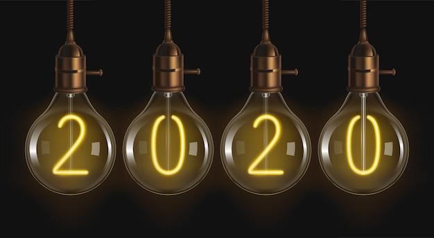Números brilhantes 2020 dentro das lâmpadas de filamento