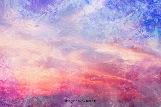 Nuvens coloridas em plano aquarela