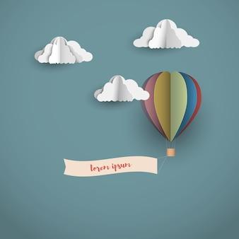 Nuvens de origami e balão de ar quente com banner
