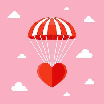 O amor está no ar. coração caindo com um para-quedas no céu.