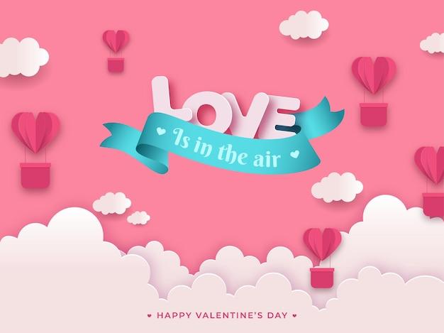 O amor está no ar mensagem texto com papel cortado coração forma balões de ar quente e nuvens no fundo rosa para o dia dos namorados.