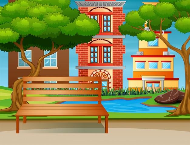 O banco de madeira e um pequeno lago em um parque da cidade