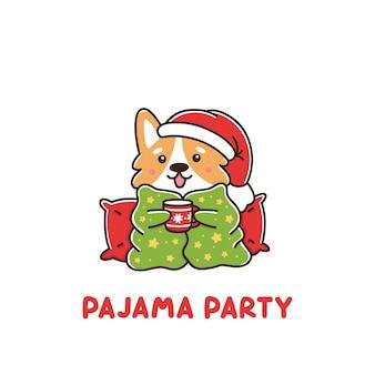 O cachorro da raça galês corgi envolto em um cobertor com uma caneca de bebida quente