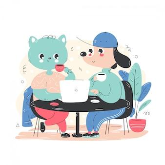 O cão e gato feliz de sorriso bonito trabalha e bebe o café.
