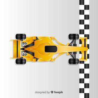 O carro de competência amarelo do f1 do inclinação cruza a linha de chegada