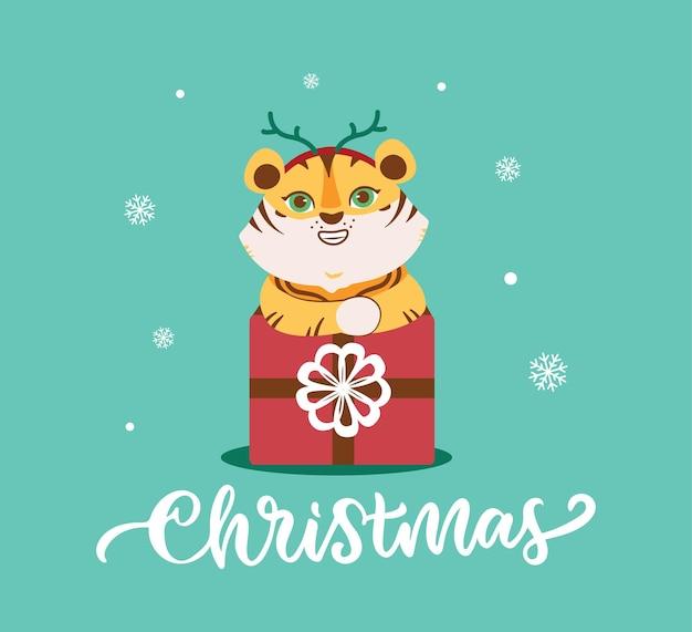 O cartão de natal com tigre o animal selvagem com presente e neve é bom para projetos de férias