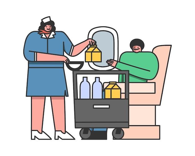 O comissário oferece comida a bordo, do carrinho para o passageiro