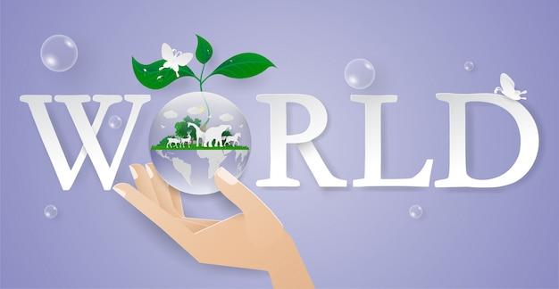 O conceito da mão salvar a água, a natureza e o wolrd com animal. meio ambiente day.world