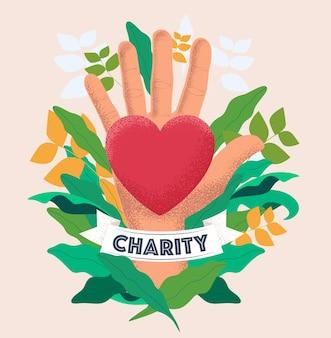 O conceito de caridade e doação com a palma da mão segura um coração vermelho em fundo floral.