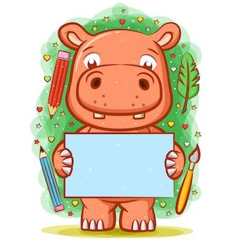 O desenho do hipopótamo segurando o papel em branco ao redor das ferramentas de escrita