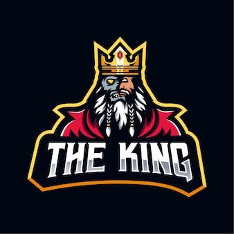 O design do logotipo king. crânio de meia face rei para equipe esport