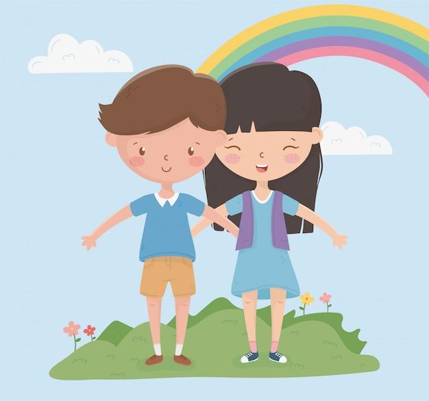 O dia das crianças felizes aprecia o arco-íris do campo da menina e do menino