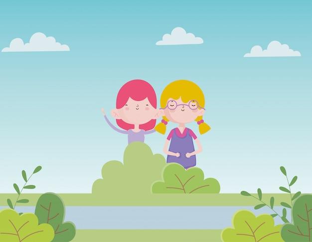 O dia das crianças felizes meninas bonitos no parque do lago ao ar livre