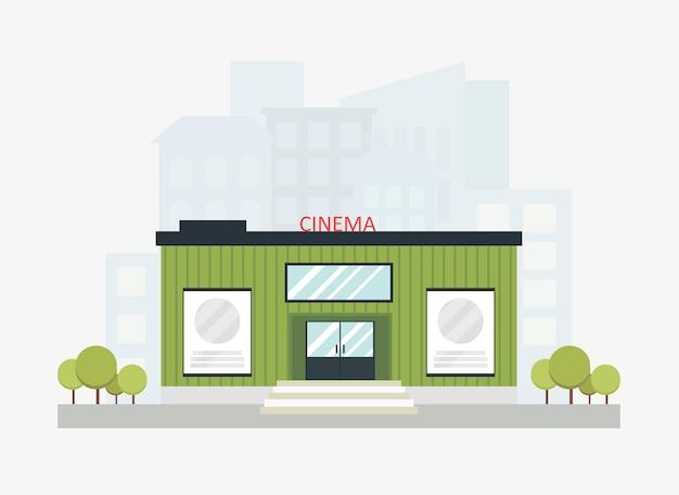 O edifício moderno do cinema com um sinal embarca com skyline da cidade. construção de cinema.