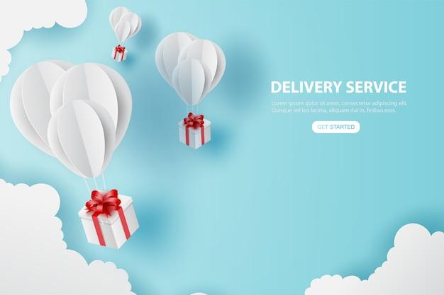O feriado do presente dos balões voa no céu azul do ar.