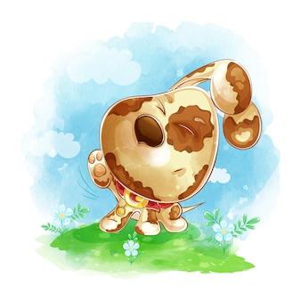 O filhote de cachorro engraçado coça sua pata traseira em um prado verde com flores.