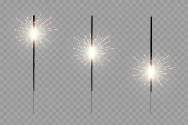 O fogo de bengala do natal brilha faíscas, fogos de artifício