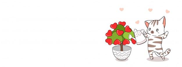 O gato adorável está plantando a árvore do amor