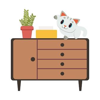 O gato bonito personagem sentado no armário marrom
