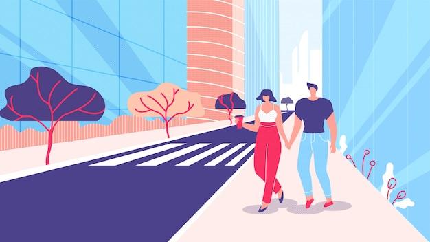 O homem e a mulher andam ao longo da megalópole da rua lisa.
