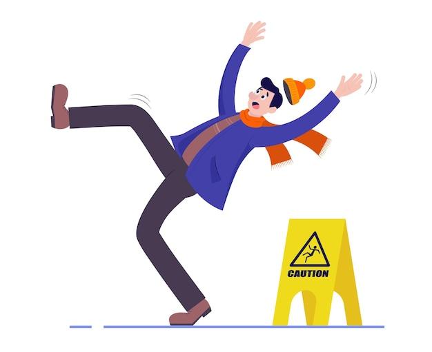 O homem escorrega e cai no chão molhado. um sinal de cautela.