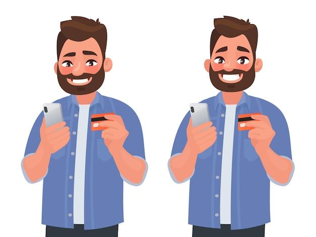 O homem feliz faz compras online com um cartão de banco pelo telefone.