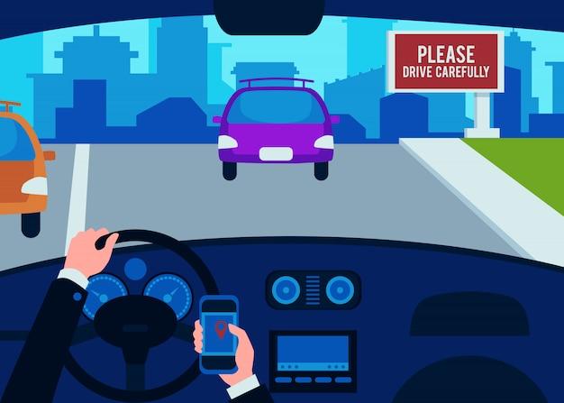 O interior do carro dentro, as mãos do motorista de um homem no volante com um telefone.