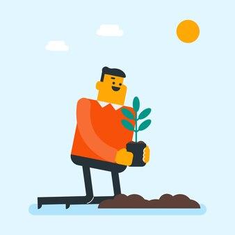 O jardineiro branco caucasiano novo planta uma árvore.