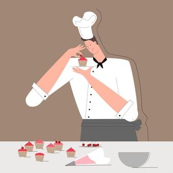 O jovem chef decora os bolos com cerejas decoração de sobremesa chef cozinheiro em uma bebida no kitche ...
