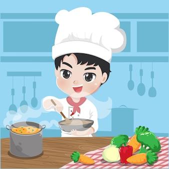 O jovem chef está cozinhando na cozinha,