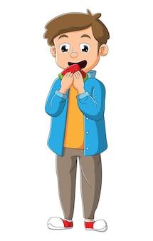 O jovem está comendo uma fatia de melancia da ilustração